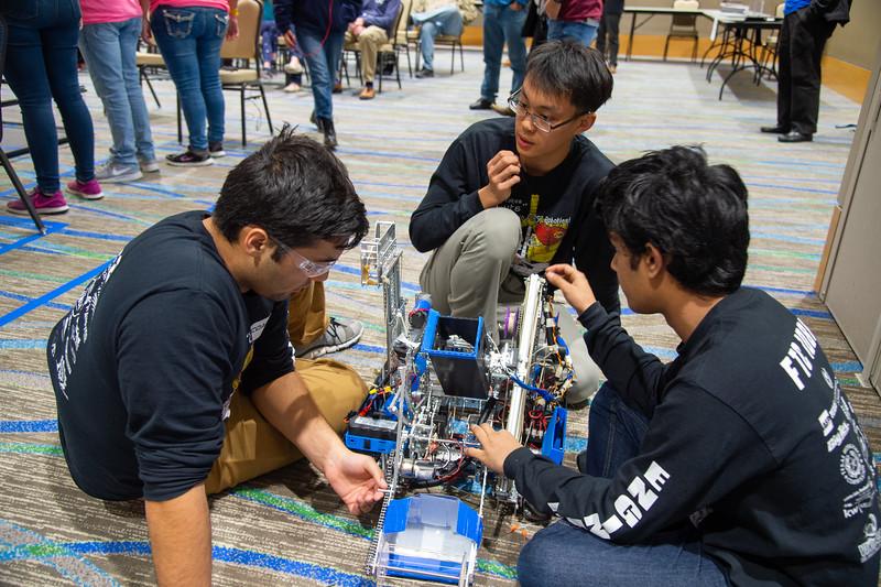 Team Droid Rage 2 repair their robot.