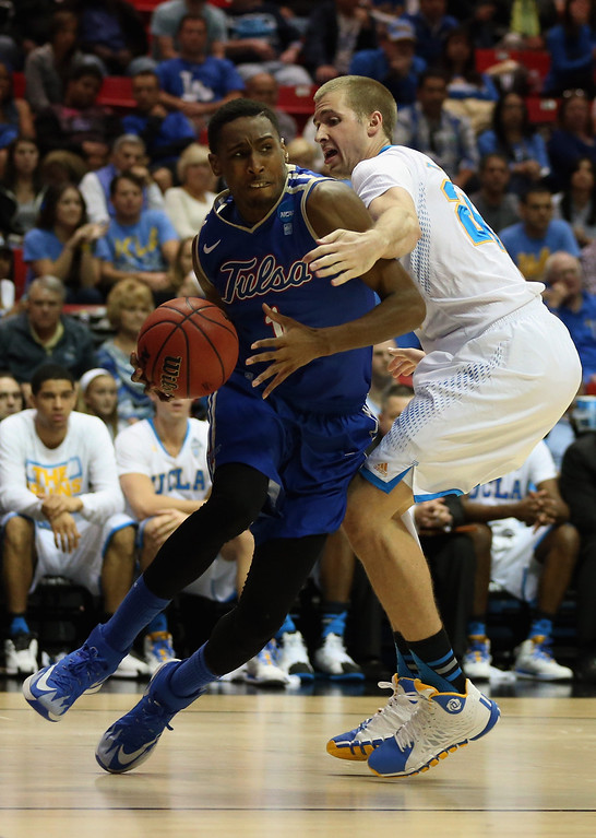 . Rashad Smith #1 of the Tulsa Golden Hurricane is defended by Travis Wear #24 of the UCLA Bruins during the second round of the 2014 NCAA Men\'s Basketball Tournament at Viejas Arena on March 21, 2014 in San Diego, California.  (Photo by Jeff Gross/Getty Images)