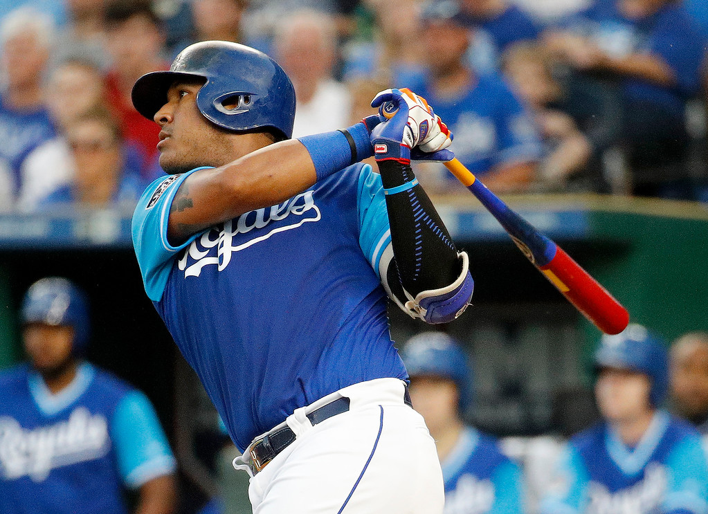 . Kansas City Royals\' Salvador Perez watches his three-run home run during the first inning of a baseball game against the Cleveland Indians on Friday, Aug. 24, 2018, in Kansas City, Mo. (AP Photo/Charlie Riedel)