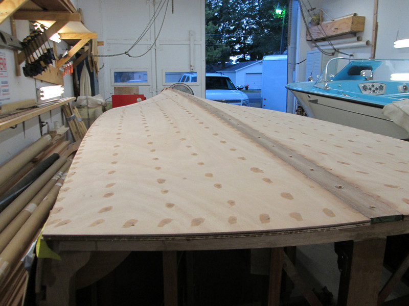 Keel cap installed and bottom screw holes puttied.
