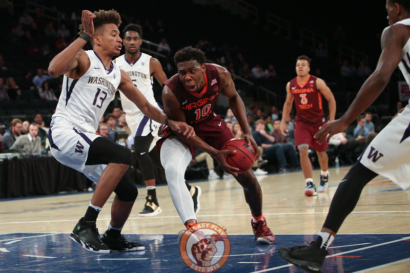 Virginia Tech's guard Justin Bibbs (10) drives past Washington's forward Hameir Wright (13) in Madison Square Garden, Nov. 17, 2017. Virginia Tech won the game 103-79.