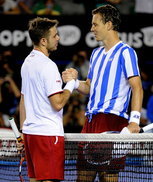 . Stanislas Wawrinka of Switzerland, left,  shakes hands with Tomas Berdych of the Czech Republic at the net after Wawrinka won their semifinal at the Australian Open tennis championship in Melbourne, Australia, Thursday, Jan. 23, 2014.(AP Photo/Andrew Brownbill)