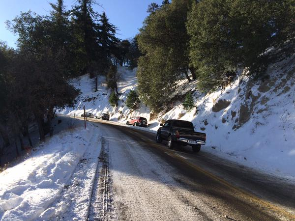 . Vehicles with chains have been making their way up Highway 138 to Crestline Wednesday morning, Dec. 31, 2014. (Photo by Sarah Alvarado/The Sun)