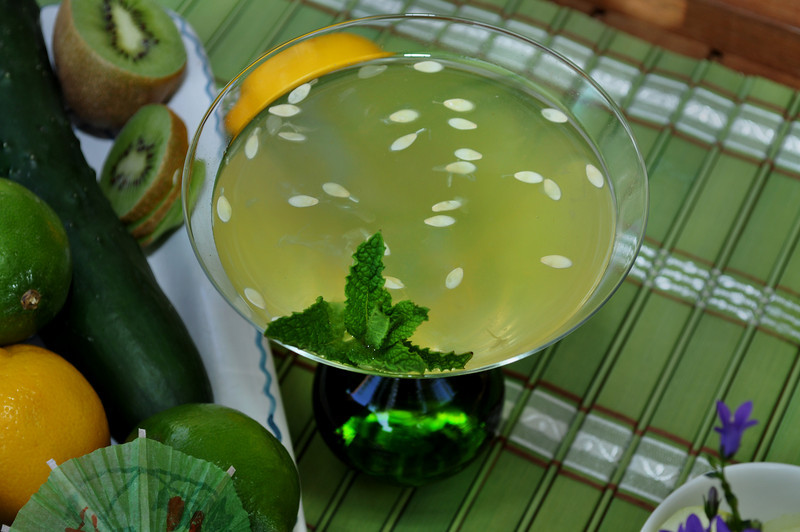 Photograph of iS Vodka Spa, a cool green Summer Cocktail from iS Vodka, refreshing summer drink made with iS Vodka, fresh cucumber and fresh lime. Recipe for iS Vodka Spa is made using iS Vodka, Soho Lychee Liqueur, Fresh Lime Juice, Pressed Cucumber & Mint. Garnish with mint.
