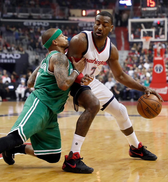 . Boston Celtics guard Isaiah Thomas, left, pushes against Washington Wizards guard John Wall during the first half of Game 6 of an NBA basketball second-round playoff series, Friday, May 12, 2017, in Washington. (AP Photo/Alex Brandon)