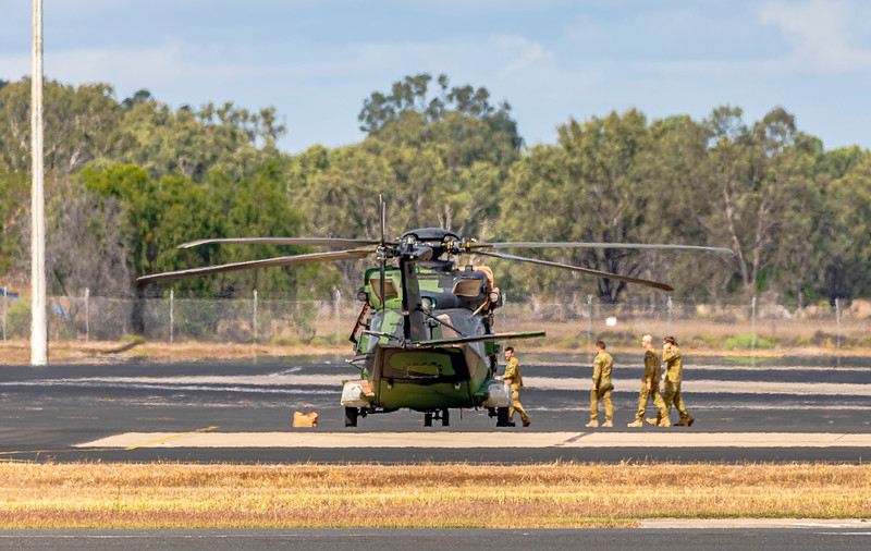 Australian Army MRH-90 A40-020 landing at Rockhampton Airport carrying spare parts for A40-026.