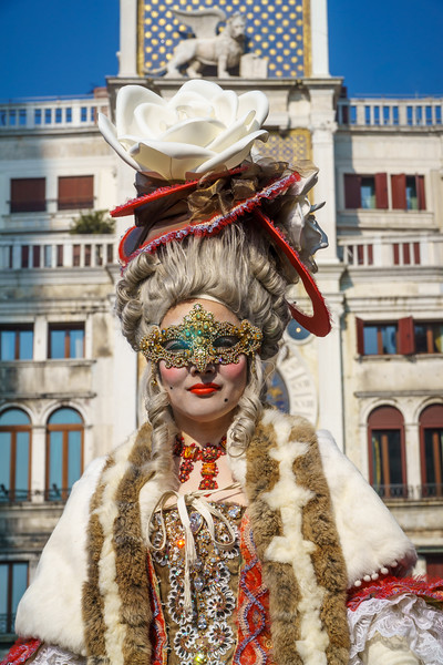 A local lady so nicely disguised and melting so well with the Venetian background (here the Clock Tower of Piazza San Marco).
