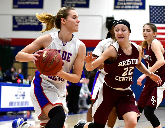 12/13/2018 Mike Orazzi | Staff Plainville High School's Caitlyn Barker (3) and Bristol Central's Kayla Beaulieu (22) during Thursday night's basketball game with Bristol Central at PHS.