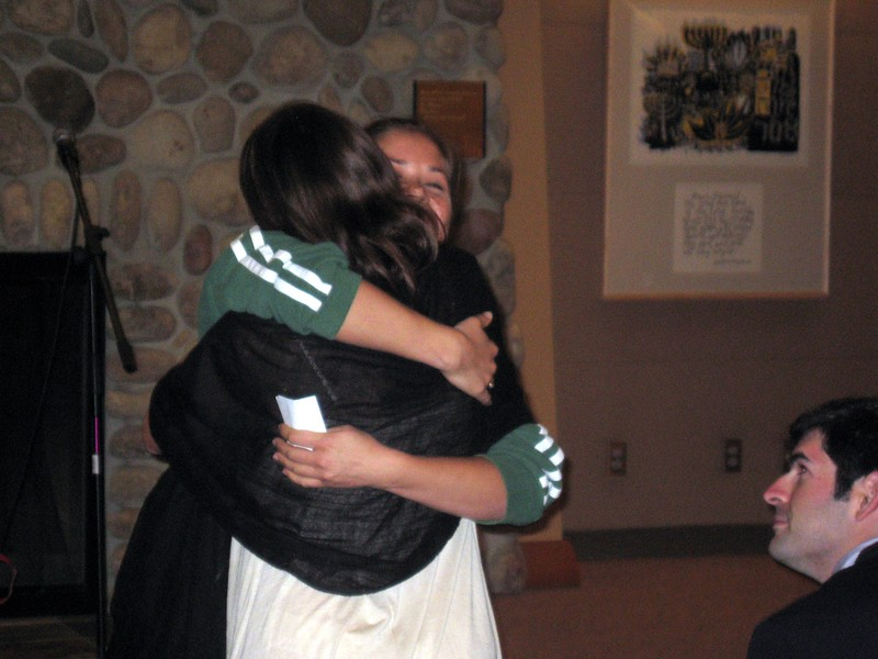 Abby hugs bridesmaid Sarah