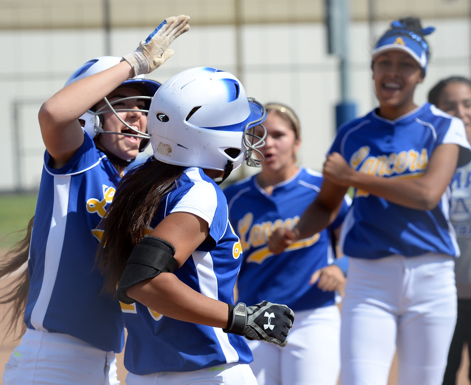 . Bishop Amat\'s Alyssa Barrera (#16) is congratulated by teammates after hitting her first homerun of the game as they play St. Paul in their Del Rey League girls softball game at York Field in Whittier on Thursday March 27, 2014. St. Paul defeated Bishop Amat 7-5. (Staff Photo by Keith Durflinger/Whittier Daily News)