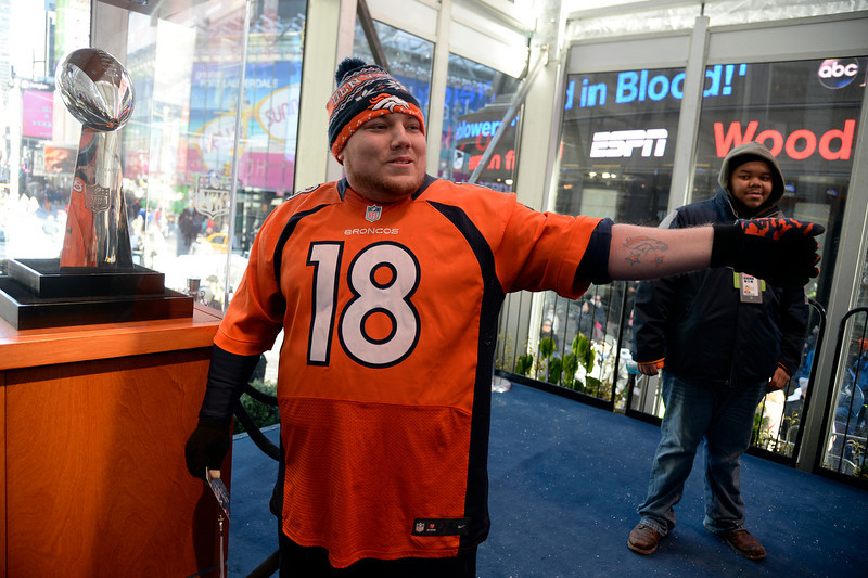 . Denver Broncos fan Corey Marte of Suffern, NY has a photo taken with the Vince Lombardi Trophy as Super Bowl XLVlll fans hit Times Square to enjoy the Super Bowl Boulevard. The NFL transformed a portion of Broadway into the sports and entertainment hub of Super Bowl Week, January 29, 2014. (Photo by John Leyba/The Denver Post)