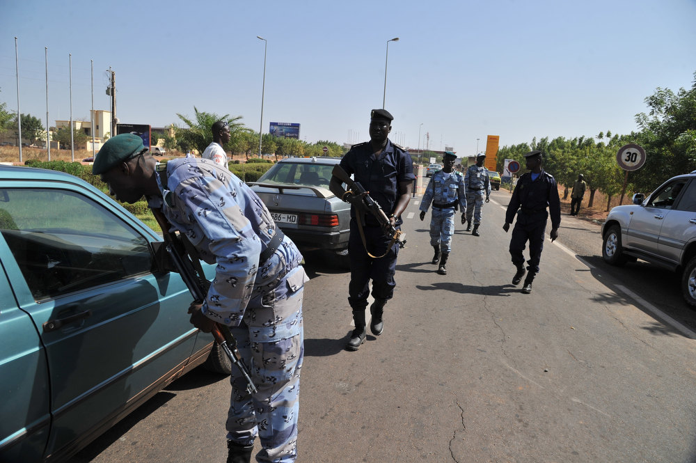 Description of . Malian police officers control cars at a checkpoint near Bamako Senou airport on January 17, 2013. France now has 1,400 troops on the ground in Mali, more than half the total of 2,500 it plans to deploy in its former colony, Defence Minister Jean-Yves Le Drian said on Thursday. France won support from European Union nations Thursday for its military campaign in Mali and offers of military aid, possibly including troops, at emergency talks on the crisis.  ISSOUF SANOGO/AFP/Getty Images