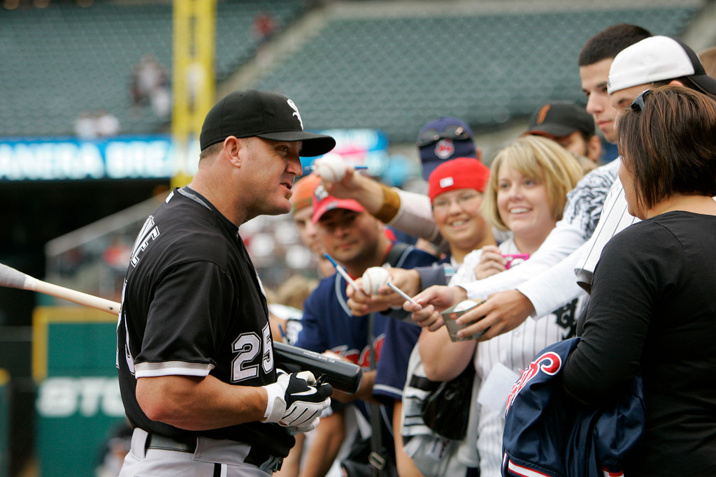 . Chicago White Sox designated hitter Jim Thome signs autographs for fans before a baseball game Wednesday, July 1, 2009, in Cleveland. (AP Photo/Mark Duncan)