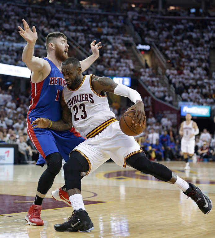 . Cleveland Cavaliers\' LeBron James (23) drive spast Detroit Pistons� Aron Baynes (12), from Australia, in the first half in Game 2 of a first-round NBA basketball playoff series, Wednesday, April 20, 2016, in Cleveland. (AP Photo/Tony Dejak)