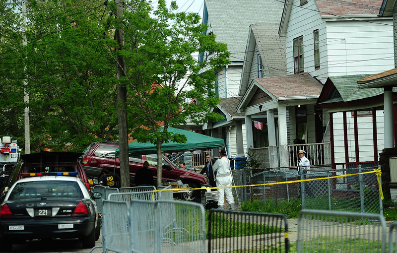 . FBI forensic personnel remove a car as evidence from the house where three women were held captive for a decade on May 7, 2013 in Cleveland, Ohio.   EMMANUEL DUNAND/AFP/Getty Images