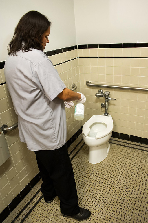 . Custodian Sanjuana Salas cleans a bathroom at L.A. City Hall, Tuesday, March 18, 2014. (Photo by Michael Owen Baker/L.A. Daily News)