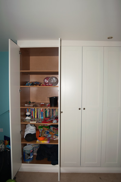 Full height shelved storage units, shaker style doors.