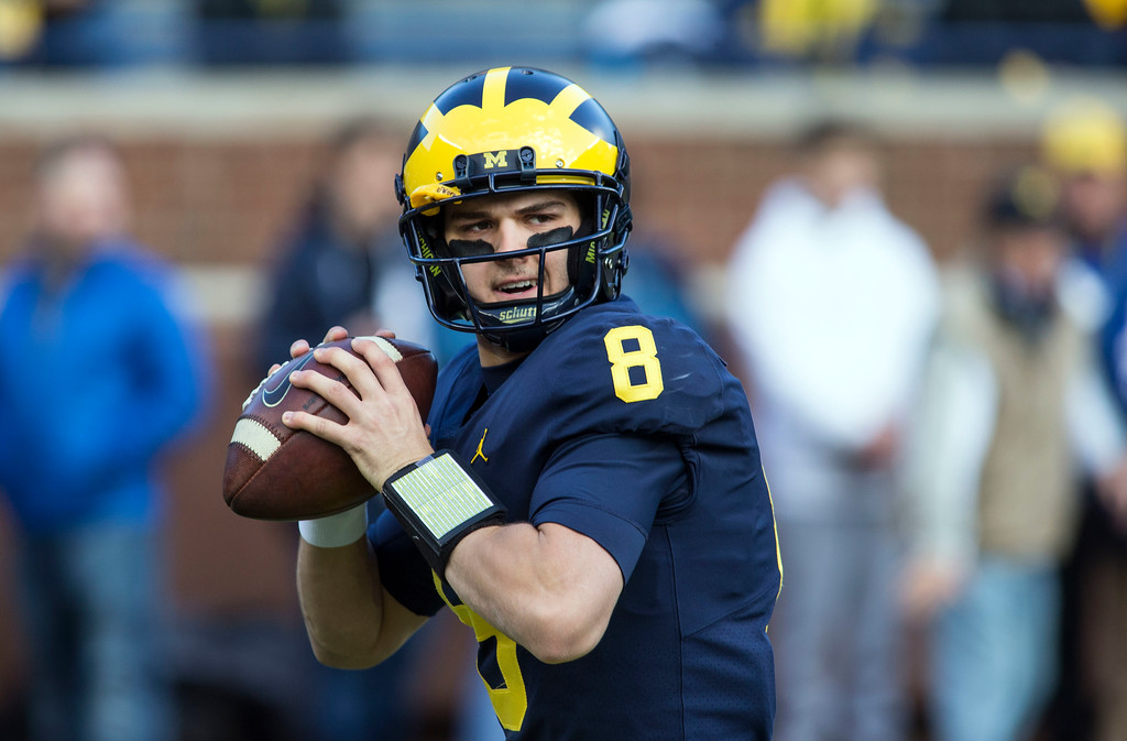 . Michigan quarterback John O\'Korn (8) warms up before an NCAA college football game against Ohio State in Ann Arbor, Mich., Saturday, Nov. 25, 2017. (AP Photo/Tony Ding)