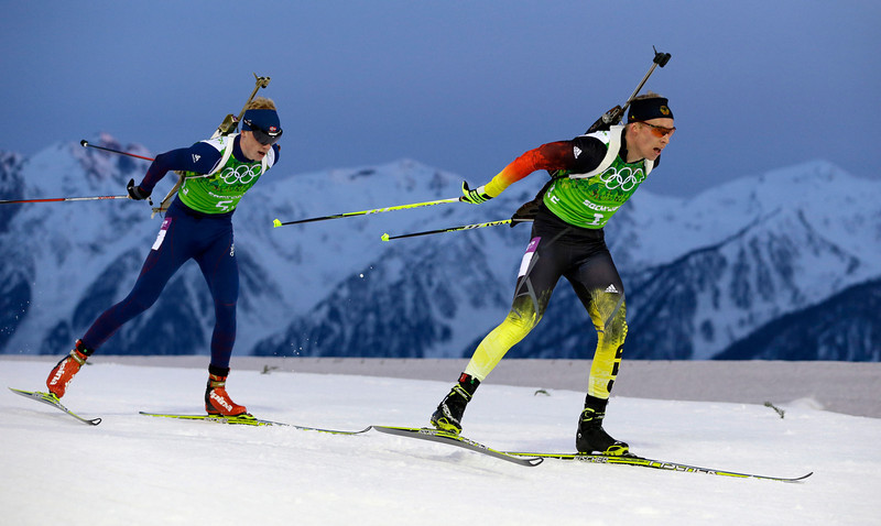 . Norway\'s Johannes Thingnes Boe, left, and Germany\'s Daniel Boehm compete during the men\'s biathlon 4x7.5K relay at the 2014 Winter Olympics, Saturday, Feb. 22, 2014, in Krasnaya Polyana, Russia. (AP Photo/Kirsty Wigglesworth)