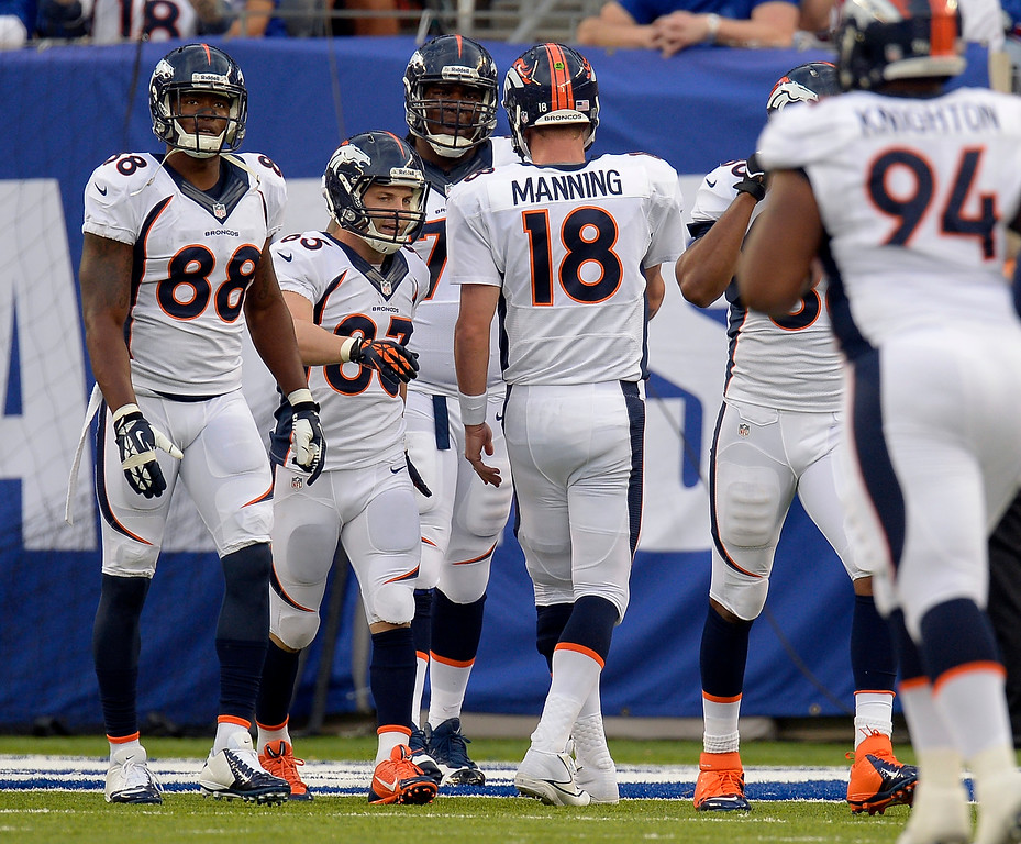 . Denver Broncos wide receiver Wes Welker (83) is congratulated by Denver Broncos quarterback Peyton Manning (18) after catching a pass for a touchdown during the third quarter September 15, 2013 MetLife Stadium. (Photo by John Leyba/The Denver Post)