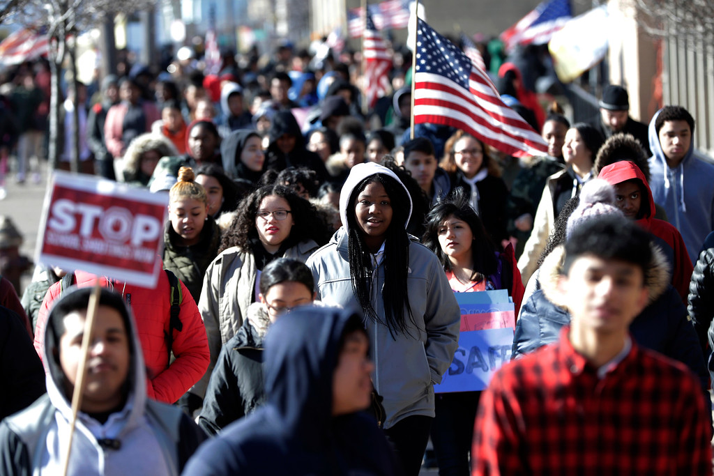 . Diamond Bryant, center, a freshman at James Ferris High School walks with classmates during a student walkout, Wednesday, March 14, 2018, in Jersey City, N.J. Students across the country planned to participate in walkouts Wednesday to protest gun violence, one month after the deadly shooting inside a high school in Parkland, Fla. (AP Photo/Julio Cortez)