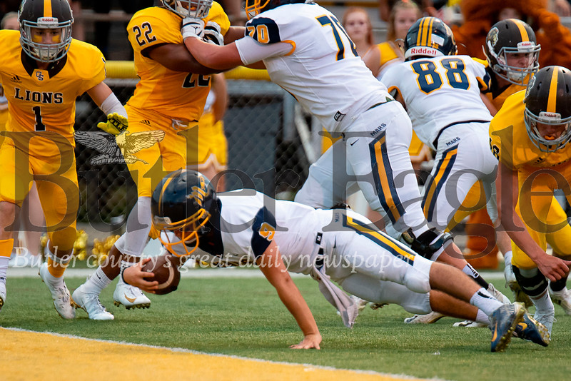 Mars quarterback Tyler Kowalkowski (9) scores on a keeper from 3 yards out late in the first quarter against Greensburg Salem on Friday, Sep. 7, 2018 at Offutt Field in Greensburg. Mars defeated Greensburg Salem 35-7.  (Ken Reabe Jr | Western PA Sports Media)
