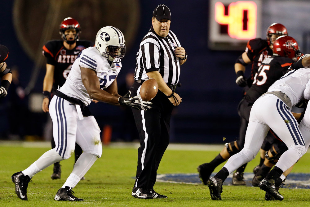 . BYU linebacker Ezekiel Ansah intercepts a tipped pass during the first half of the Poinsettia Bowl NCAA college football game against San Diego State, Thursday, Dec. 20, 2012, in San Diego. (AP Photo/Lenny Ignelzi)