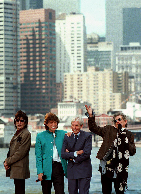 """. NEW YORK, UNITED STATES:  Against the backdrop of lower Manhattan the Rolling Stones announce their upcoming \""""Bridges to Babylon\"""" concert tour 18 August. (L to R) Ron Wood, Mick Jagger, Charlie Watts and Keith Richards.       AFP PHOTO/Jon LEVY (Photo credit should read JON LEVY/AFP/Getty Images)"""