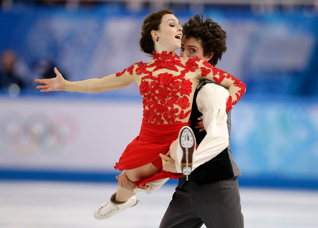 . Alexandra Paul and Mitchell Islam of Canada compete in the ice dance free dance figure skating finals at the Iceberg Skating Palace during the 2014 Winter Olympics, Monday, Feb. 17, 2014, in Sochi, Russia. (AP Photo/Darron Cummings)