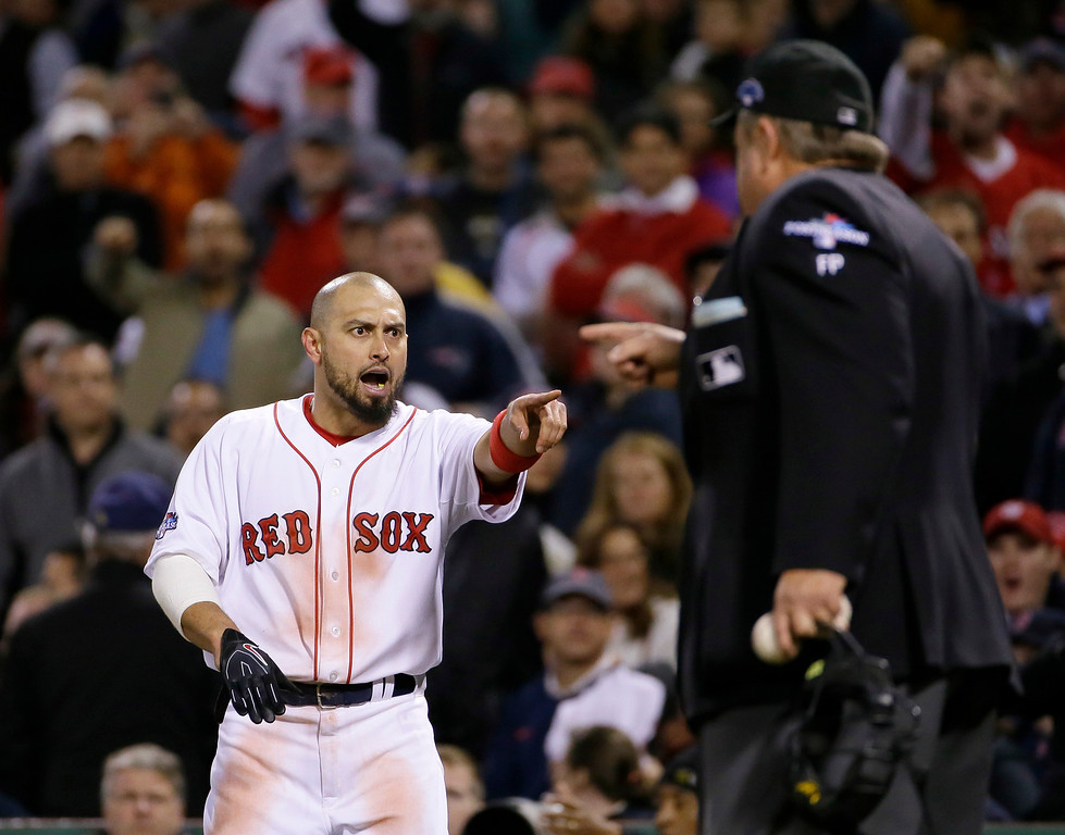 . Boston Red Sox\'s Shane Victorino, left, argues with umpire Joe West, right, during the  seventh inning in Game 1 of the American League baseball championship series against the Detroit Tigers Saturday, Oct. 12, 2013, in Boston. (AP Photo/Matt Slocum)