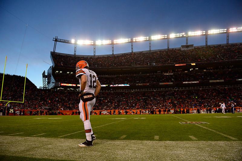 . Cleveland Browns quarterback Colt McCoy (12) walks the sidelines during the second half.  The Denver Broncos vs Cleveland Browns at Sports Authority Field Sunday December 23, 2012. AAron Ontiveroz, The Denver Post