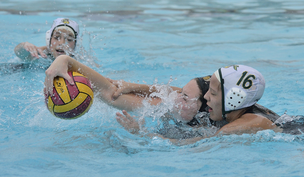 . LONG BEACH, CALIF. USA -- Wilson\'s Sarah Sheldon (5) battles for the ball with Poly\'s Asha Pluton (16) in Long Beach, Calif., on February 7, 2013. Wilson defeated Poly, 6 to 5, to win the Moore League. Photo by Jeff Gritchen / Los Angeles Newspaper Group