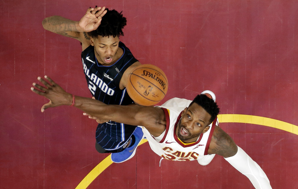 . Cleveland Cavaliers\' Jeff Green, right, tries to block shot by Orlando Magic\'s Elfrid Payton during the second half of an NBA basketball game Thursday, Jan. 18, 2018, in Cleveland. The Cavaliers won 104-103. (AP Photo/Tony Dejak)