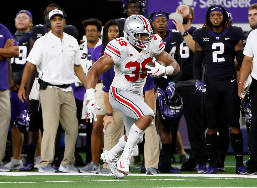 . Ohio State linebacker Malik Harrison (39) runs back an interception against TCU during the second half of an NCAA college football game in Arlington, Texas, Saturday, Sept. 15, 2018. Ohio State won 40-28. (AP Photo/Michael Ainsworth)