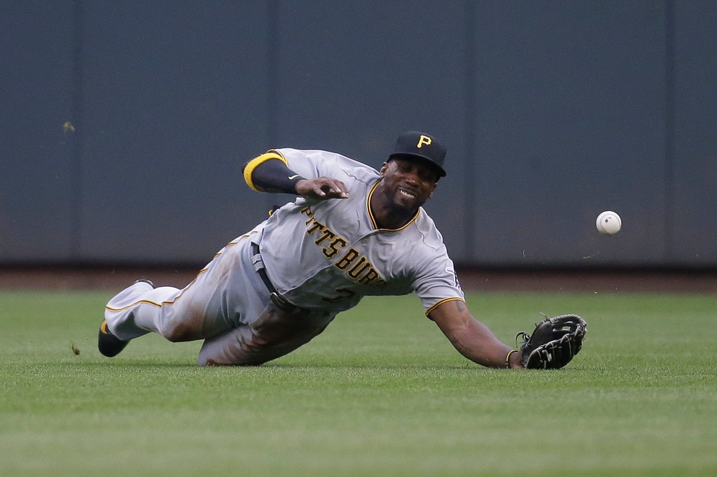 . Pittsburgh Pirates center fielder Andrew McCutchen misses a single hit by Cincinnati Reds\' Billy Hamilton off starting pitcher Jonathon Niese in the first inning of a baseball game, Monday, May 9, 2016, in Cincinnati. (AP Photo/John Minchillo)