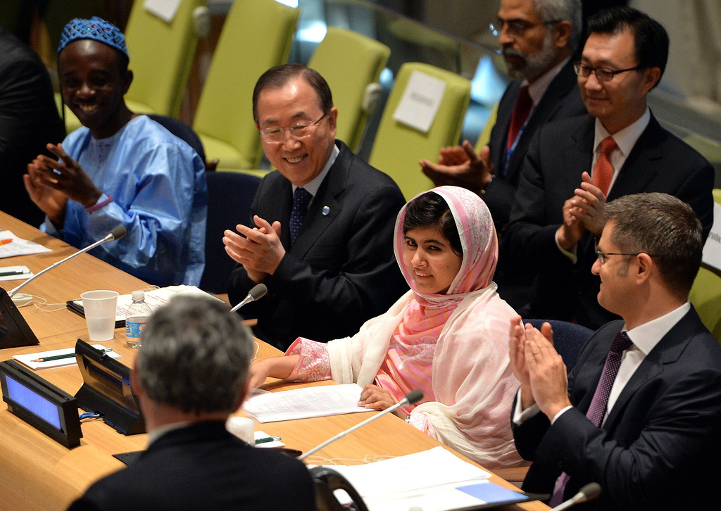 ". Pakistani student Malala Yousafzai is greeted by United Nations Secretary General Ban Ki-Moon (2nd L), Vuk Jeremic (R), President of the UN General Assembly, and Gordon Brown (L, back to camera), United Nations Special Envoy for Global  Education July 12, 2013 at UN headquarters in New York during the UN Youth Assembly. Yousafzai became a public figure when she was shot by the Taliban while travelling to school last year in Pakistan -- targeted because of her committed campaigning for the right of all girls to an education. The UN had declared July 12 ""Malala Day\"", which is also Yousafzai\'s birthday.   STAN HONDA/AFP/Getty Images"