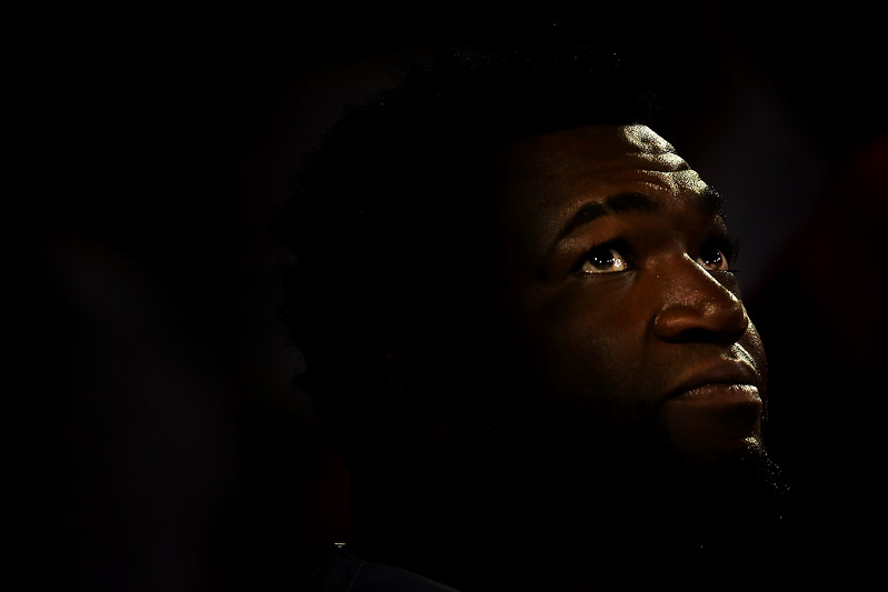 David Ortiz #34 of the Boston Red Sox looks on from the dugout in the third inning during the game against the Detroit Tigers at Fenway Park on July 26, 2016 in Boston, Massachusetts.