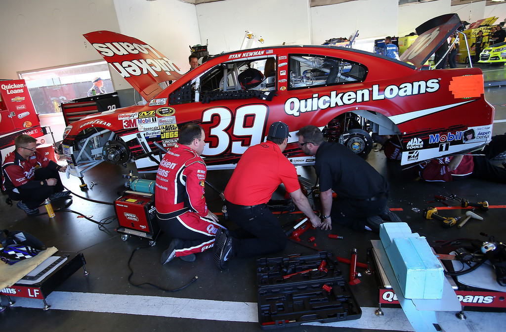 . DAYTONA BEACH, FL - FEBRUARY 20:  Ryan Newman, driver of the #39 Quicken Loans Chevrolet, and crew members work on their car in the garage during practice for the NASCAR Sprint Cup Series Daytona 500 at Daytona International Speedway on February 20, 2013 in Daytona Beach, Florida.  (Photo by Jonathan Ferrey/Getty Images)