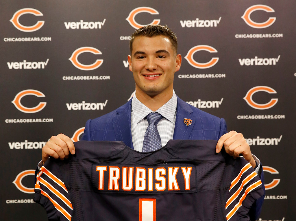 . Chicago Bears\' first round draft pick quarterback Mitchell Trubisky, from North Carolina, poses with a Bears\' jersey during an NFL football news conference Friday, April 28, 2017, in Lake Forest , Ill. (AP Photo/Charles Rex Arbogast)