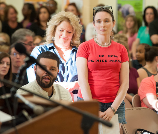 05/21/18 Wesley Bunnell   Staff A meeting of the New Britain Board of Ed took place to a packed standing room only crowd at Vance School on Monday night regarding recently announced changes for the upcoming 18-19 school year. Nora Pasco-Burns, who has a child in the New Britain school system, stands in line for her turn to speak.