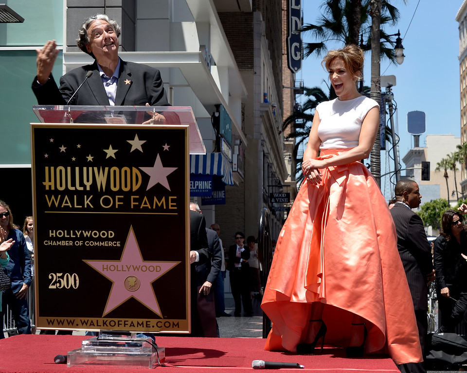 . US actress, singer Jennifer Lopez (R) laughs as US director Gregory Nava (L) speaks during Lopez\' star ceremony on the Hollywood Walk of Fame in Hollywood, California, USA 20 June 2013. Lopez was awarded the 2,500th star on the Hollywood Walk of Fame in the category of Recording.  EPA/PAUL BUCK