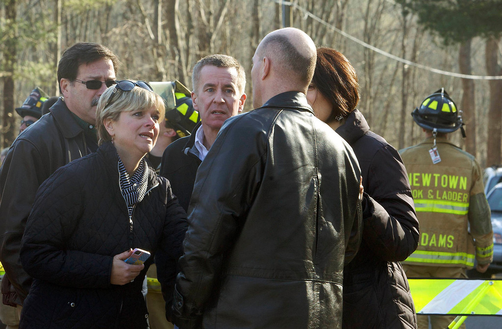 . Parents talk to a man outside Sandy Hook Elementary School after a shooting in Newtown, Connecticut, December 14, 2012.  At least 27 people, including children, were killed on Friday when at least one shooter opened fire at the elementary school in Newtown, Connecticut, CBS News reported, citing unnamed officials.  REUTERS/Michelle McLoughlin