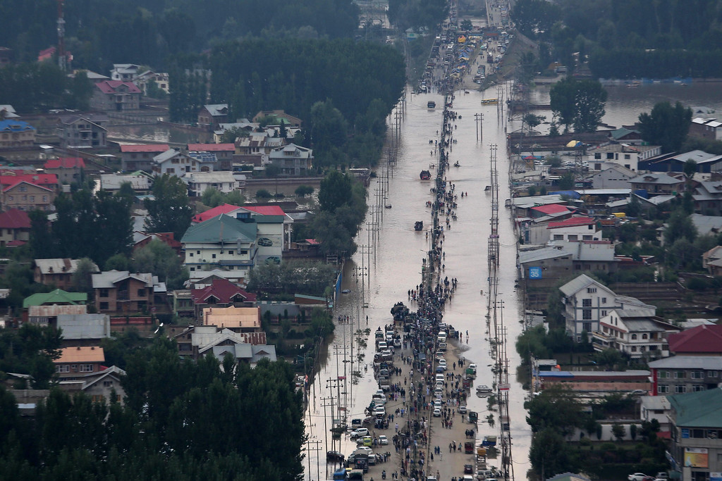 . People and vehicles are surrounded by floodwaters in Srinagar, India, Tuesday, Sept. 9, 2014.  The flooding began earlier this month in Kashmir, where it has caused landslides and submerged much of the main city of Srinagar, on the Indian-administered side.  (AP Photo/Dar Yasin)