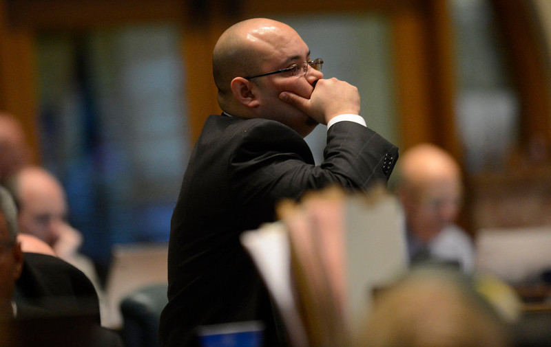 . Rep. Joe Salazar, D-Thornton , listens to Rep. Bob Gardner, R-Colorado Springs, debate Senate Bill 11, allowing same sex couples to form civil unions, March, 11, 2013. Last year, Democrats had the votes to pass the bill, but Republicans stalled to call it up for debate. (Photo By RJ Sangosti/The Denver Post)
