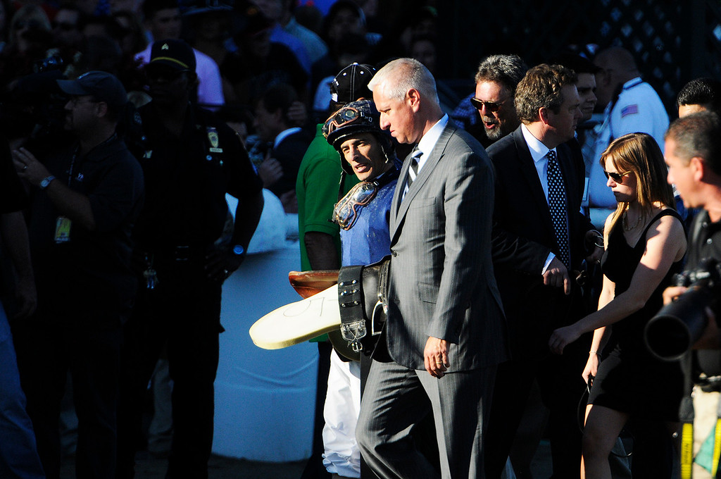 . Trainer of Verrazano and Palace Malice Todd Pletcher with a frown on his face leaves the track with jockey Johnny Velazquez after not winning the Travers this Saturday afternoon at the Saratoga Race Course.Photo Erica Miller/The Saratogian 8/24/13 ToddJohnnyEM1