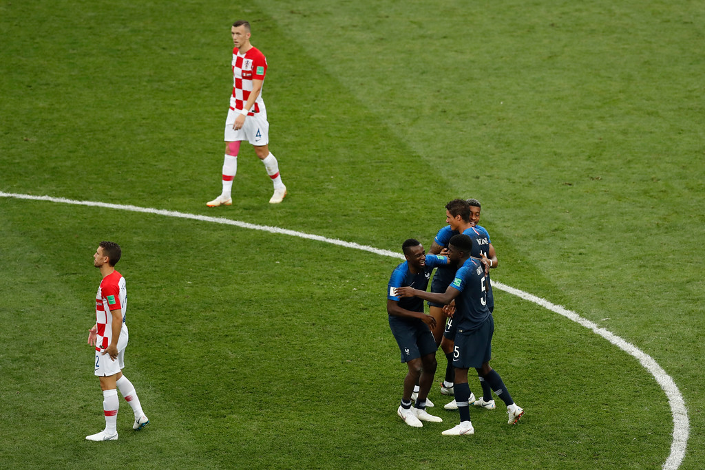 . French players celebrate at the end of the final match between France and Croatia at the 2018 soccer World Cup in the Luzhniki Stadium in Moscow, Russia, Sunday, July 15, 2018. (AP Photo/Rebecca Blackwell)