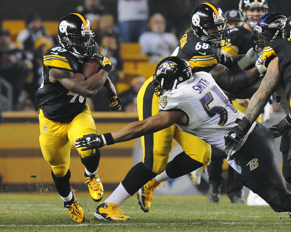 . Pittsburgh Steelers running back Josh Harris (40) gets around Baltimore Ravens inside linebacker Daryl Smith (51) in the third quarter of an NFL wildcard playoff football game, Saturday, Jan. 3, 2015, in Pittsburgh. (AP Photo/Don Wright)
