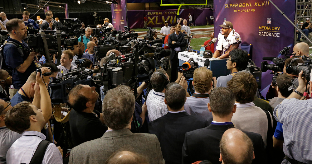 . Baltimore Ravens linebacker Ray Lewis (52) is surrounded by reporters during media day for the NFL Super Bowl XLVII football game Tuesday, Jan. 29, 2013, in New Orleans. (AP Photo/Mark Humphrey)
