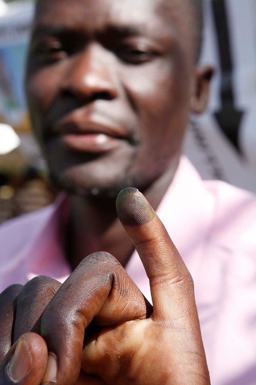 . A man shows his marked finger after he voted at a polling station in Kisumu, western Kenya on March 4, 2013 during the nationwide elections. Long lines of Kenyans queued from way before dawn to vote Monday in the first election since the violence-wracked polls five years ago, with a deadly police ambush hours before polling started marring the key ballot. The tense elections are seen as a crucial test for Kenya, with leaders vowing to avoid a repeat of the bloody 2007-8 post-poll violence in which over 1,100 people were killed and observers repeatedly warning of the risk of renewed conflict.      Till Muellenmeister/AFP/Getty Images