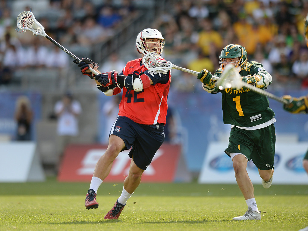 . COMMERCE CITY, CO - JULY 17: US midfielder Max Seibald (42) took a shot from outside past Australia defender Sam Bullock (1) in the first half. Team USA faced Australia in a FIL World Championship semifinal game Thursday night, July 17, 2014.  Photo by Karl Gehring/The Denver Post